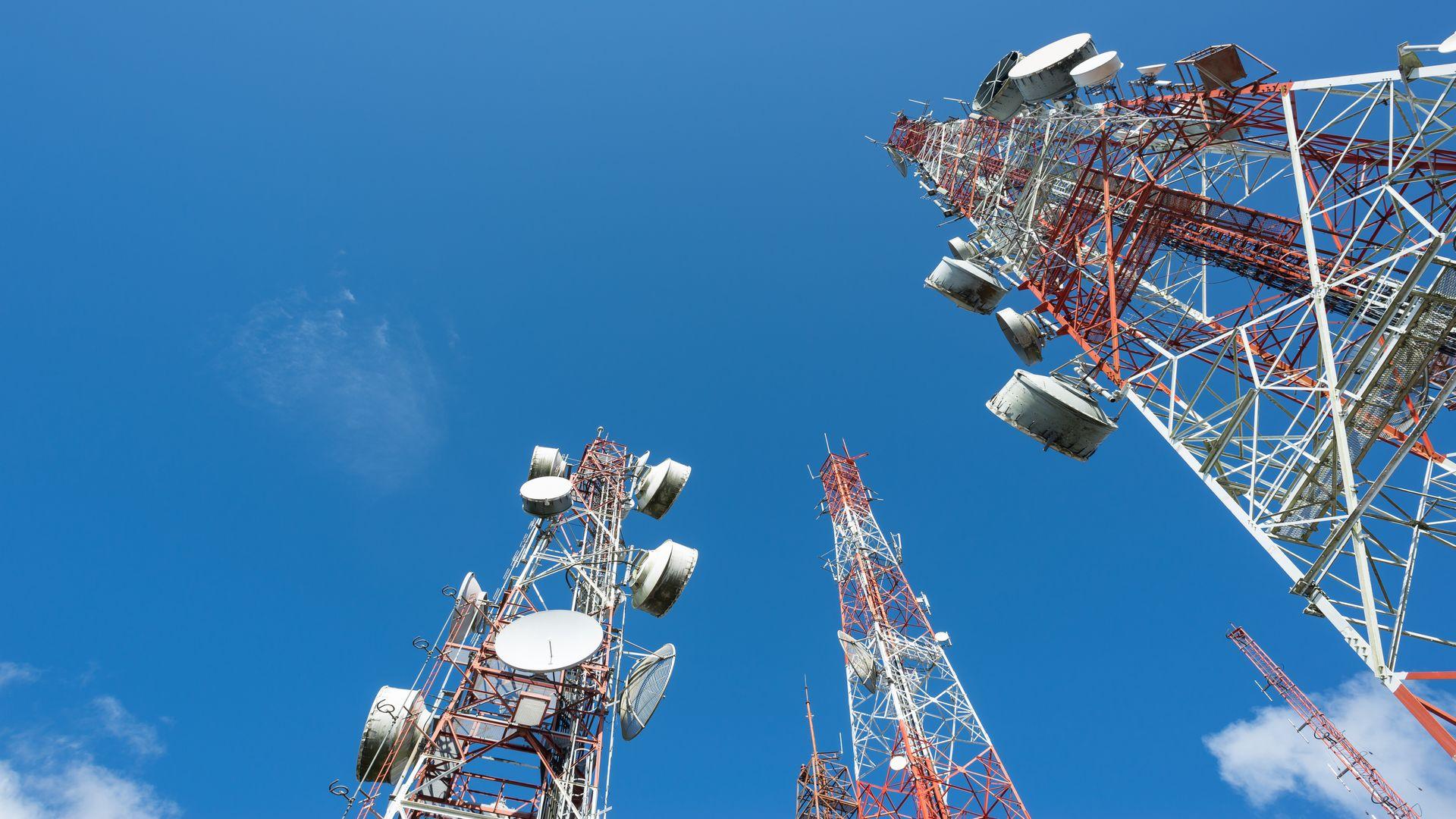 Three big radio mast with blue sky