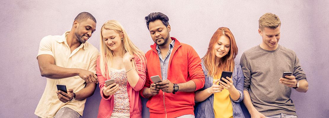 people-standing-wall-phones