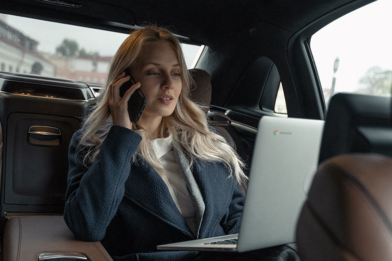 business-woman-car-phone-laptop-chrome-800×533